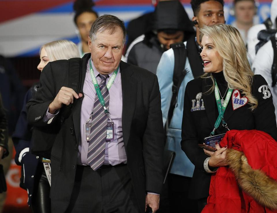 Coach Bill Belichick and his girlfriend Linda Holliday.