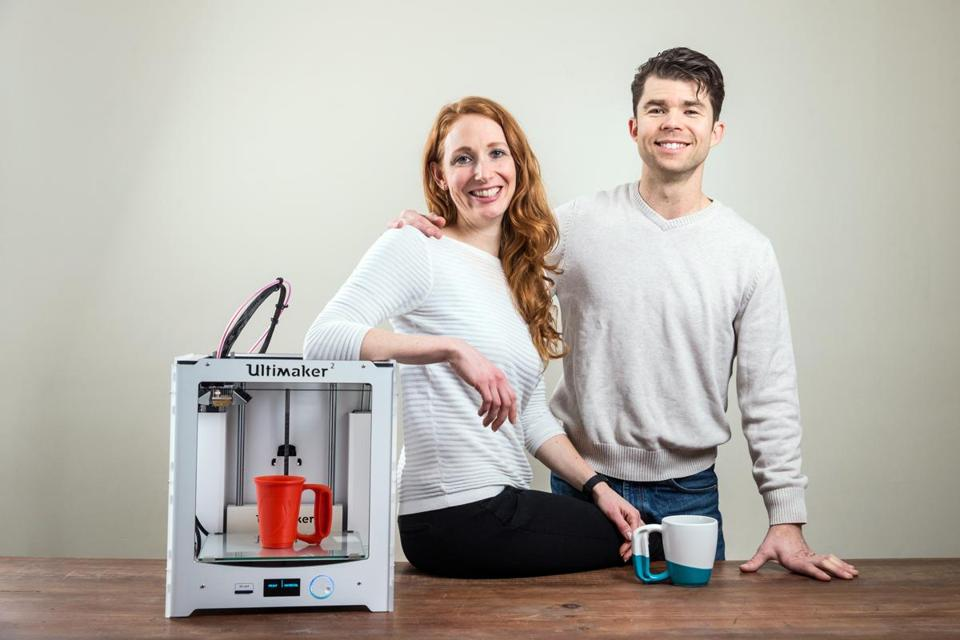 Diana and Allen Arseneau, Jamber cofounders, with a 3-D printer used to prototype the product.