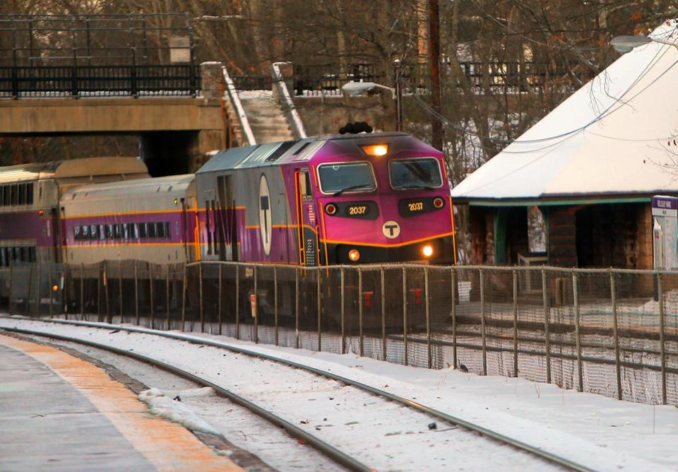 Wellesley, MA - 1/03/17 - An outbound MBTA commuter rail train drops off passengers at the Wellesley Farms stop. (Lane Turner/Globe Staff) Reporter: (vaccaro) Topic: (04mbtaprep)