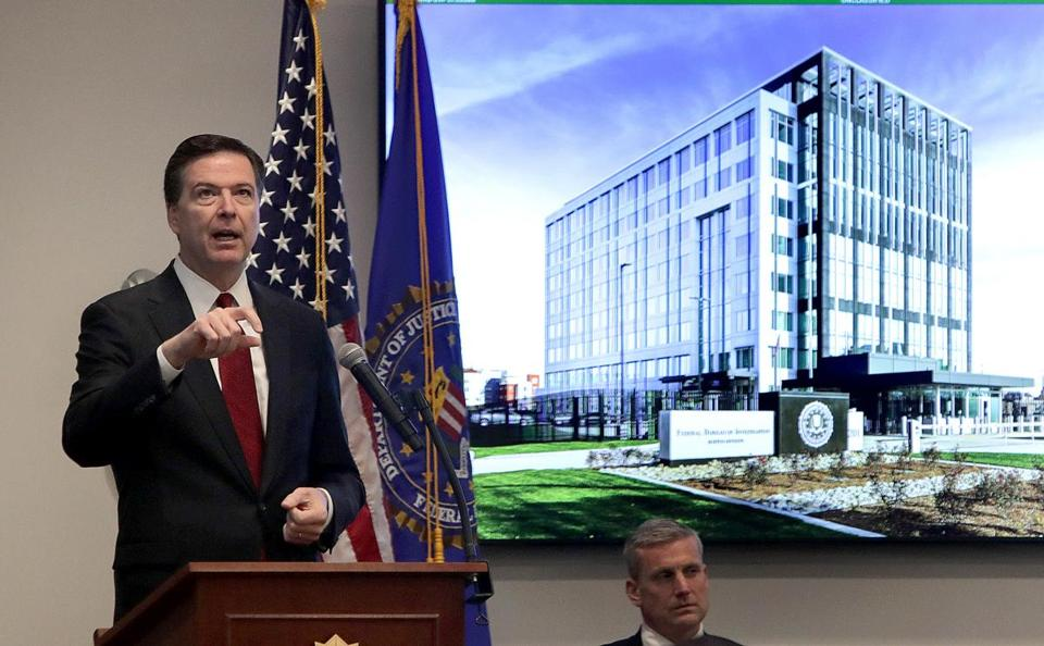 Then-FBI director James Comey spoke at a ribbon-cutting ceremony for the FBI's new facility in Chelsea, while Harold Shaw, special agent in charge of Boston's FBI division, looked on last year.
