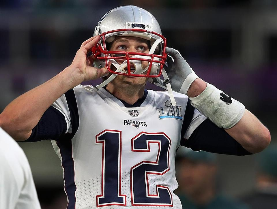 Minneapolis, MN - 2/4/2018 - Patriots quarterback Tom Brady puts on his helmet during pre game warmups before Super Bowl LII. The New England Patriots play the Philadelphia Eagles in Super Bowl LII at US Bank Stadium in Minneapolis on Feb. 4, 2018. (Jim Davis/Globe Staff)