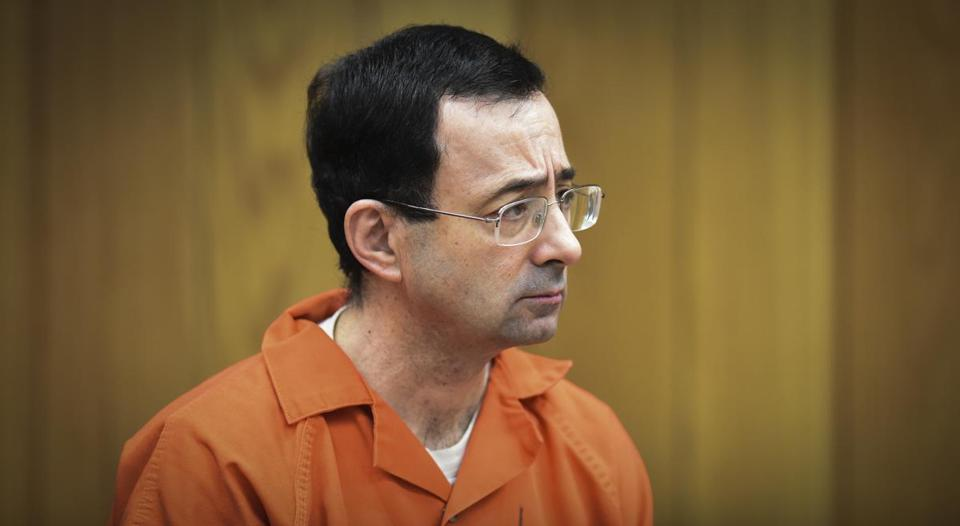 There was little reaction in Larry Nassar's face as he was sentenced Monday, Feb. 5, 2018, in Judge Janice Cunningham's Eaton County Court in Charlotte, Mich., where Nassar was sentenced to 40-125 years in prison on three counts of sexual assault. (Matthew Dae Smith/Lansing State Journal via AP)