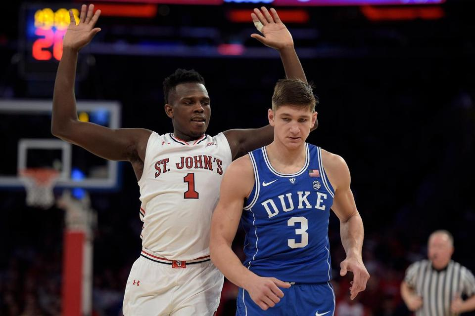 NEW YORK, NY - FEBRUARY 03: Bashir Ahmed #1 of the St. John's Red Storm reacts after bumping into Grayson Allen #3 of the Duke Blue Devils at Madison Square Garden on February 3, 2018 in New York City. (Photo by Lance King/Getty Images)
