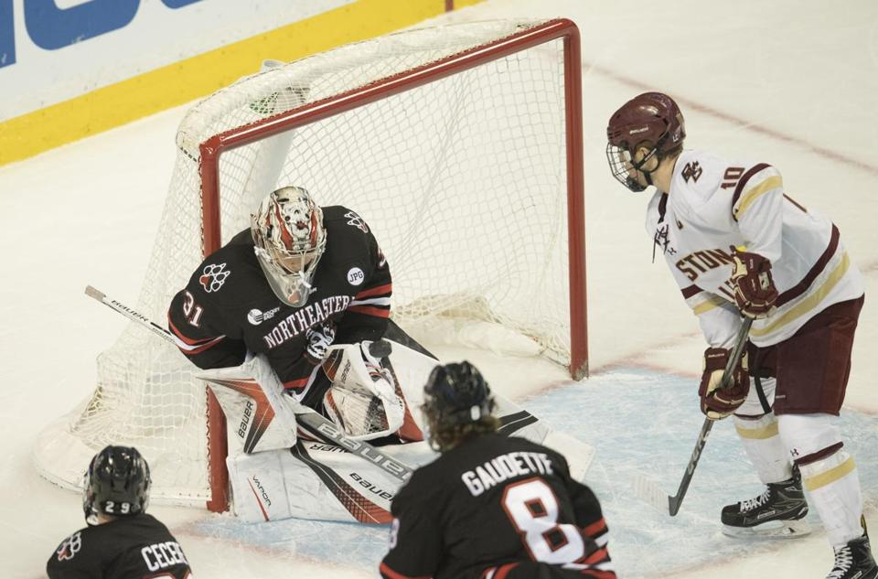 Boston, MA - 2/5/2018 - Northeastern Goalie 31 Cayden Primeau with a 2nd period save. Boston college #10 Christopher Brown looking for the rebound. 66th Beanpot tournament (John Cetrino for The Boston Globe) SPORTS Barbara Matson (matson)