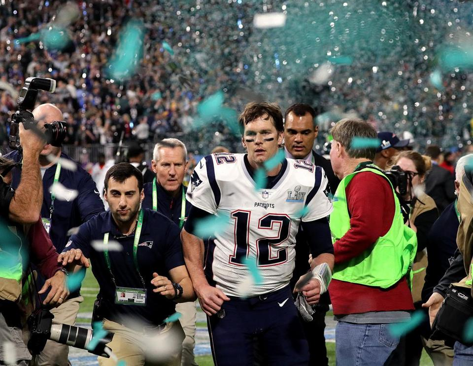 Patriots quarterback Tom Brady left the field after New England lost to the Philadelphia Eagles in Sunday night's Super Bowl.