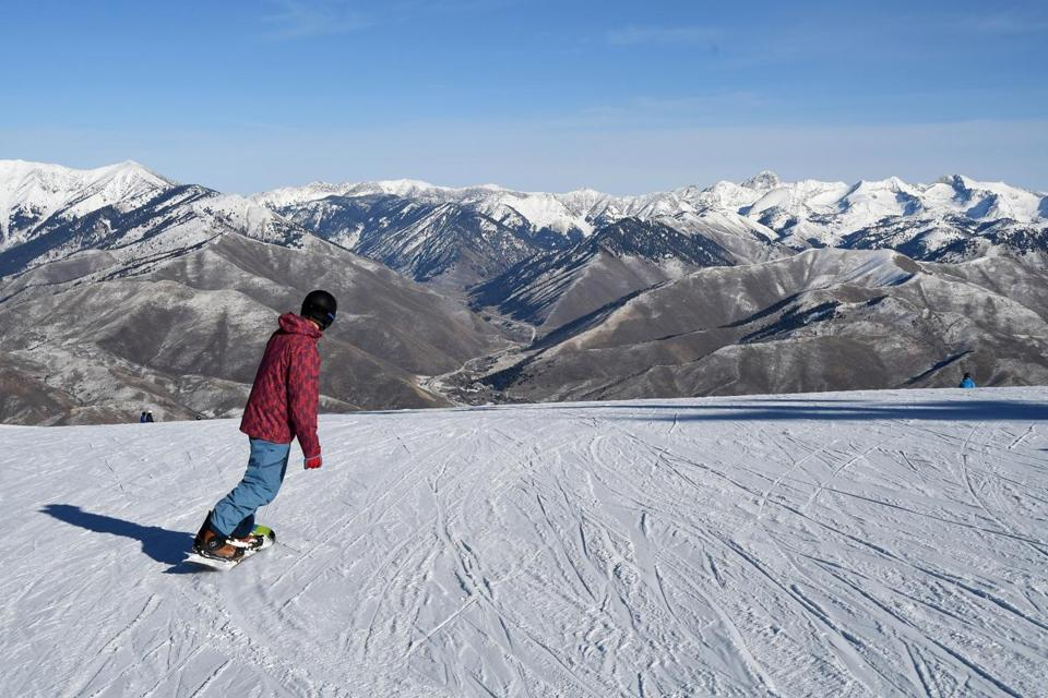 A snowboarder carves down Bald Mountain, which has 100 runs and a 3,400-foot vertical drop, at Sun Valley Resort in Idaho.