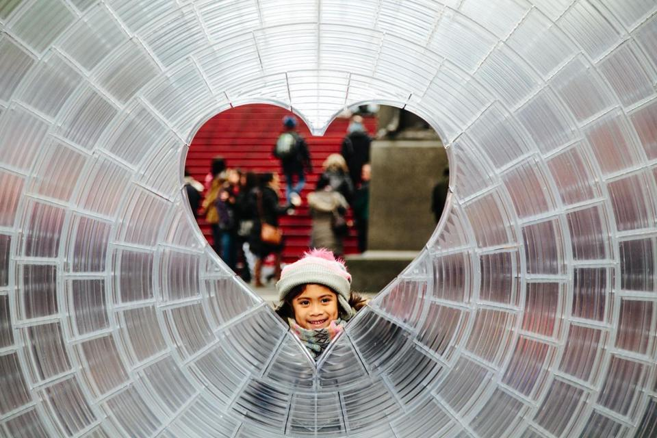 Mandatory Credit: Photo by ALBA VIGARAY/EPA-EFE/REX/Shutterstock (9351299c) A little girl poses for photos in Aranda\Lasch + Marcelo Coelho's 'Window to the Heart' in Times Square in New York, New York, USA, 01 February 2018. The 12 foot in diameter sculpture was designed with 3D printing and will be free and open to the public through the month of February, in celebration of Valentine?s Day. 'Window to the Heart' is unveiled for Valentine's Day in Times Square in New York, USA - 01 Feb 2018