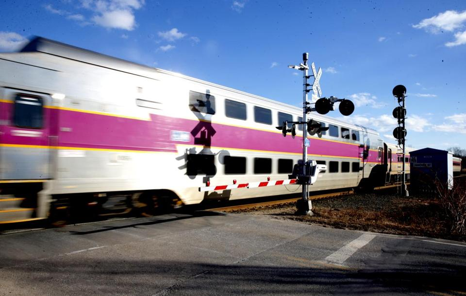 02/03/2018 Newburyport Ma--A MBTA commuter train passing a grade crossing as it makes's its way toward Newburyport Station. Jonathan Wiggs /Globe Staff Reporter:Topic.