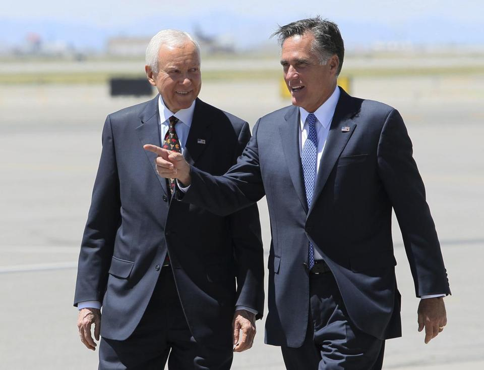 FILE - In this June 8, 2012, file photo, Republican presidential candidate and former Massachusetts Gov. Mitt Romney, left, walks alongside. U.S. Senator Orrin Hatch, R-Utah on the tarmac of Salt Lake City International Airport, in Salt Lake City. Romney is considering a new career in Congress. Those who know the 70-year-old former Republican presidential nominee best expect him to announce plans to seek a suddenly vacant Utah Senate seat. Incumbent Orrin Hatch announced Tuesday that he would not seek re-election this fall. ()