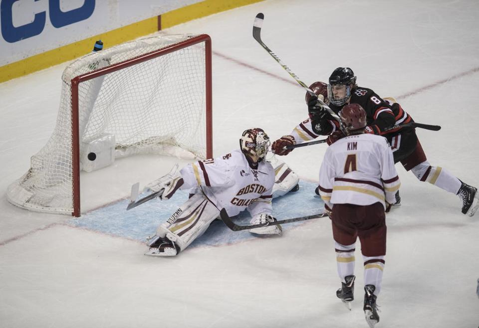 Boston, MA - 2/5/2018 - The puck get by Boston college Goalie #31Joseph Woll 3rd period. (left) Northeastern #8 Adam Gaudette with the goal. BC#4 Michael Kim (bottom) 66th Beanpot tournament (John Cetrino for The Boston Globe) SPORTS Barbara Matson (matson)