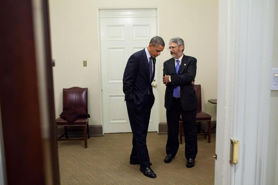 President Obama talked with Dr. John Holdren, then his science adviser, in November 2010. Holdren, a professor at Harvard University's Kennedy School of Government, is concerned that President Trump still hasn't named a science adviser.