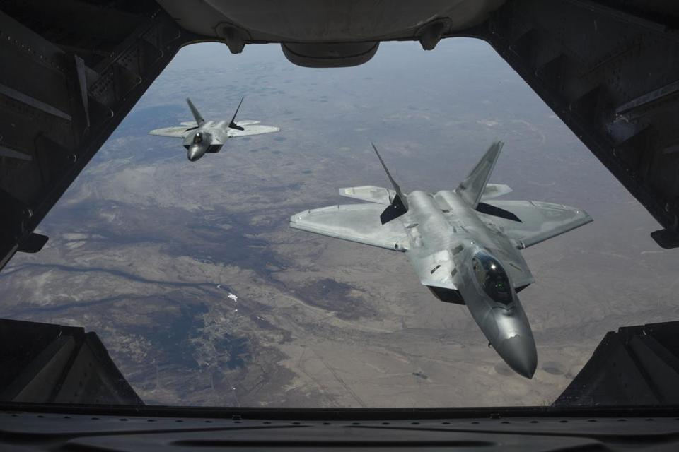 A photo from the U.S. Air Force of two F-22 Raptor fighter jets as seen from another plane above Syria for Operation Inherent Resolve, Feb. 2, 2018. The American-backed coalition in Syria has repelled an attack by forces supporting the Assad government, carrying out deadly strikes Wednesday night, Feb. 8, 2018, in a rare confrontation between competing factions that have both fought the Islamic State. (Colton Elliott/U.S. Air Force via The New York Times) -- FOR EDITORIAL USE ONLY. --