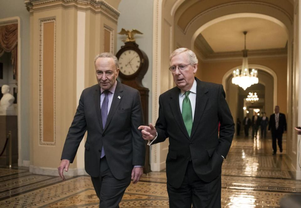 Senate Majority Leader Mitch McConnell, R-Ky., and Senate Minority Leader Chuck Schumer, D-N.Y., left, walk to the chamber after collaborating on an agreement in the Senate on a two-year, almost $400 billion budget deal that would provide Pentagon and domestic programs with huge spending increases, at the Capitol in Washington, Wednesday, Feb. 7, 2018. (AP Photo/J. Scott Applewhite)
