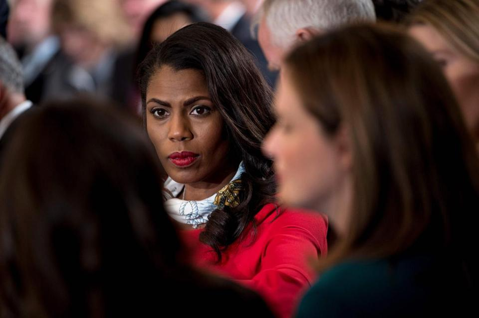 "(FILES) In this file photo taken on October 26, 2017 Omarosa Manigault, former White House Director of Communications for the Office of Public Liaison, waits to hear US President speak on combatting drug demand and the opioid crisis at the the White House in Washington, DC. Reality TV star turned political operative turned reality TV star Omarosa Manigault has issued a cryptic warning that things are ""bad"" inside the White House and the public should be worried. The fiery former star who was pushed out of the White House appeared in a preview of the February 8, 2018 ""Celebrity Big Brother,"" warning all is not well in that other Big House at 1600 Pennsylvania Avenue.""I was haunted by tweets every single day, like what is he gonna tweet,"" she told a fellow contestant in what was billed as a candid late-night exchange with a costar. / AFP PHOTO / Brendan SmialowskiBRENDAN SMIALOWSKI/AFP/Getty Images"