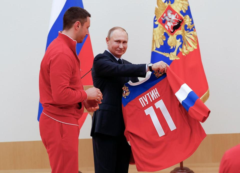 "Hockey player Ilya Kovalchuk, with Vladimir Putin, said ""everyone knows"" where the Russian athletes are from. ""The flag is in our heart."""