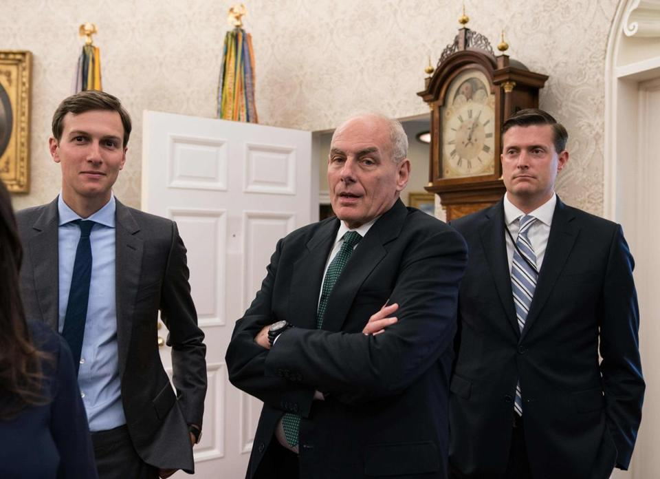 "(FILES) In this file photo taken on September 1, 2017 White House senior adviser Jared Kushner (L), White House chief of staff John Kelly (C) and White House staff secretary Rob Porter look on after US President Donald Trump signed a proclamation calling for a national day of prayer on September 3 for those affected by Hurricane Harvey in the Oval Office at the White House in Washington, DC. White House staff secretary Rob Porter -- a near-constant fixture at President Donald Trump's side -- has resigned from his post, after two ex-wives publicly accused him of domestic abuse. The White House said Porter denied the allegations and retains the confidence of Trump and his chief of staff John Kelly, but would be leaving his post at an undetermined time.The Daily Mail had recently suggested he was in a relationship with Trump's communications advisor Hope Hicks. ""The President and chief of staff have had full confidence and trust in his abilities and his performance,"" said press secretary Sarah Sanders on February 7, 2018. / AFP PHOTO / NICHOLAS KAMMNICHOLAS KAMM/AFP/Getty Images"