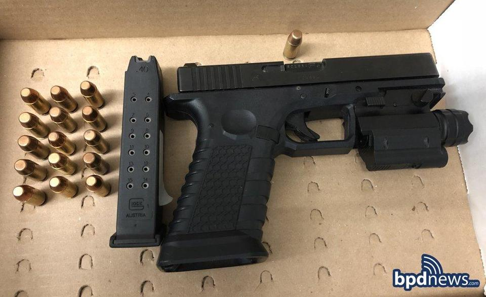Police recovered a loaded Glock 22 .40-caliber pistol with a large-capacity feeding device from two men in Mattapan Friday morning.