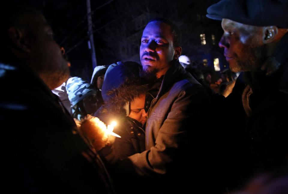 Edson Brito and his daughter Tamia embrace following a vigil in memory of his two sons, 8-year-old Edson Brito and 5-year-old Lason Brito, in Brockton on Thursday.