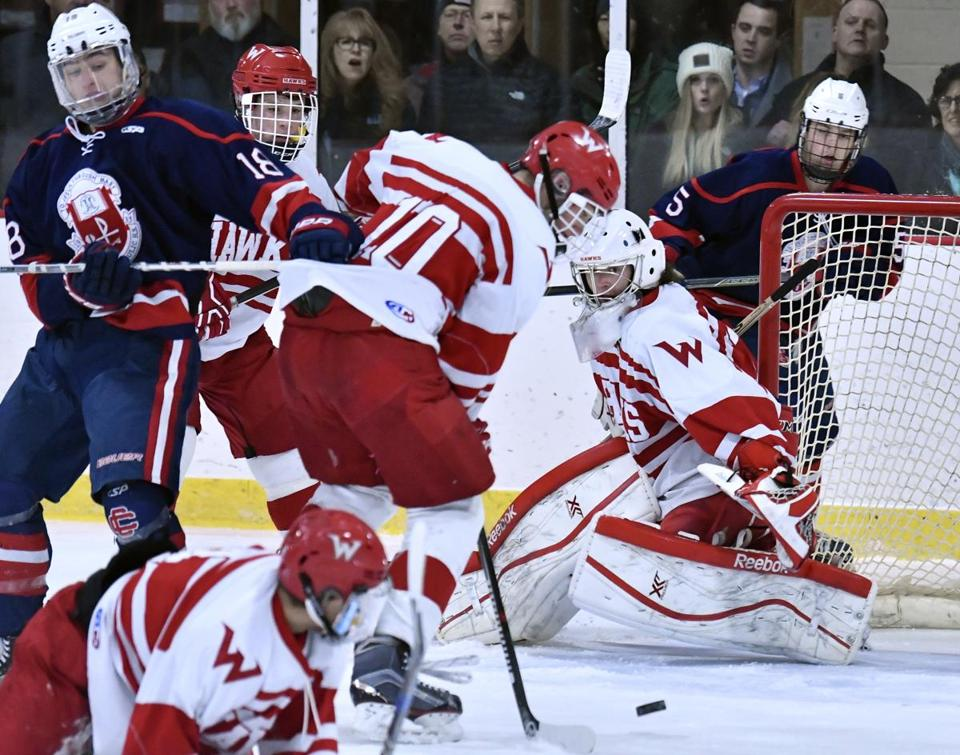 Waltham' goalie Kyle Penton (29) keeps his eye on the puck during a scramble in fromt of the net with of Top-ranked Central Catholic during their matchup at Waltham. Josh Reynolds for The Boston Globe (Sports, souza)
