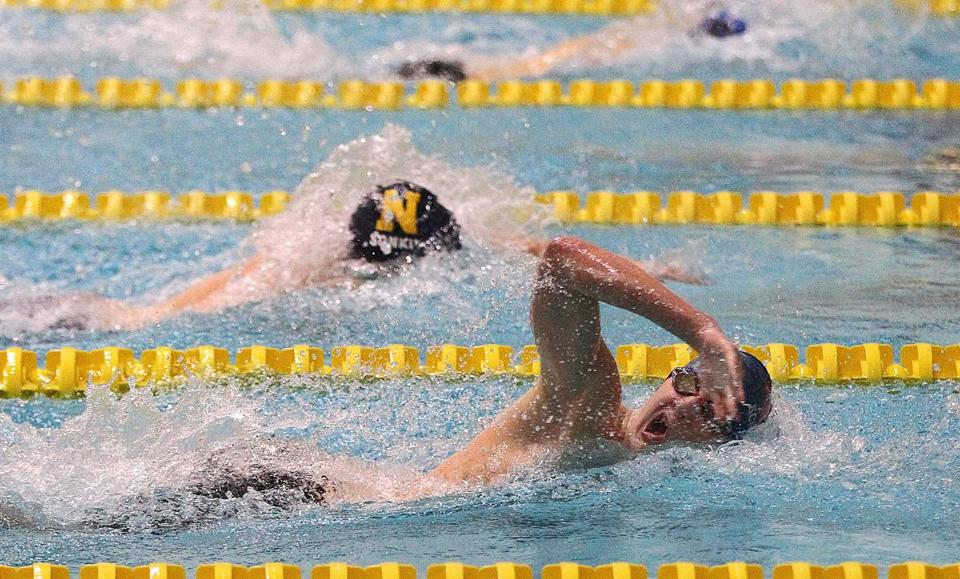 Natick's Ben Schmelmer edges Needham's Sergey Sonkin on the first leg of the 400-yard freestyle relay.