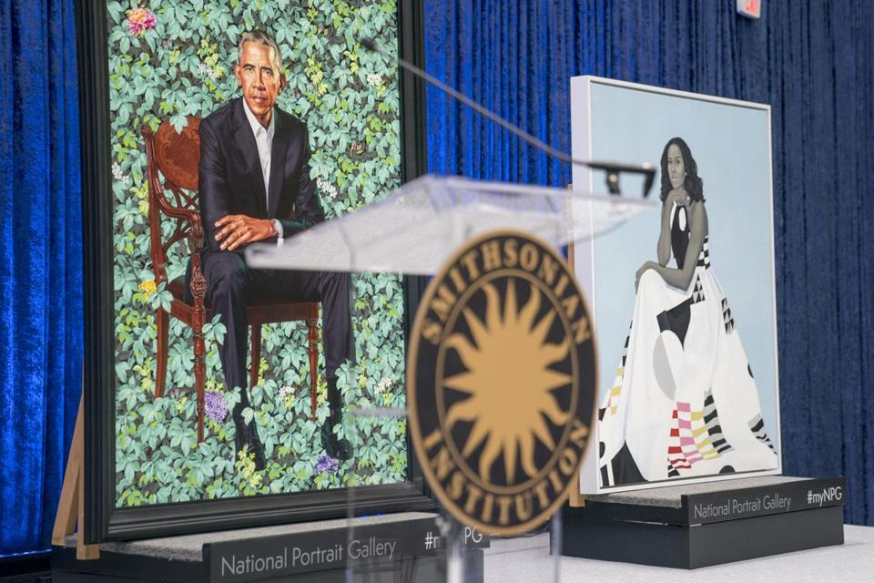 The official portraits of former President Barack Obama and former first lady Michelle Obama are displayed together following an official unveiling ceremony at the Smithsonian's National Portrait Gallery, Monday, Feb. 12, 2018, in Washington.