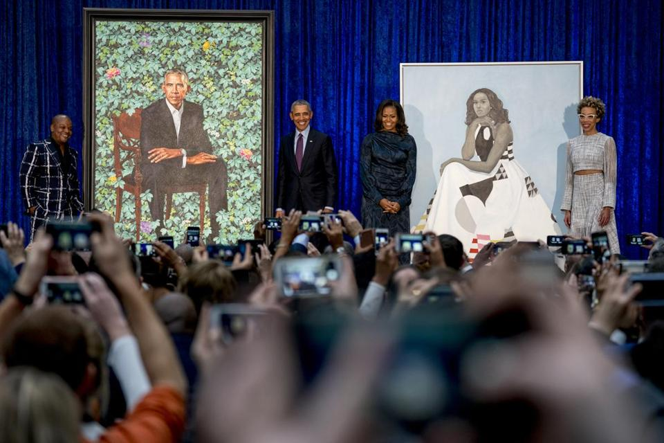 From left: Artist Kehinde Wiley, Barack Obama, Michelle Obama, and artist Amy Sherald.