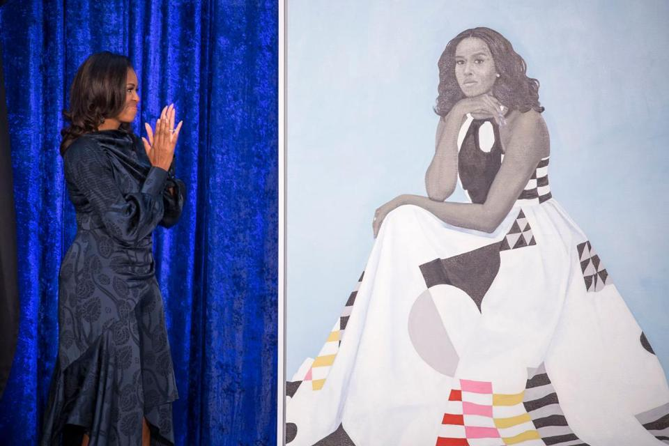 Former US First Lady Michelle Obama stands before her portrait by artist Amy Sherald after an unveiling at the Smithsonian's National Portrait Gallery in Washington, DC, February 12, 2018. / AFP PHOTO / SAUL LOEB / RESTRICTED TO EDITORIAL USE - MANDATORY MENTION OF THE ARTIST UPON PUBLICATION - TO ILLUSTRATE THE EVENT AS SPECIFIED IN THE CAPTIONSAUL LOEB/AFP/Getty Images