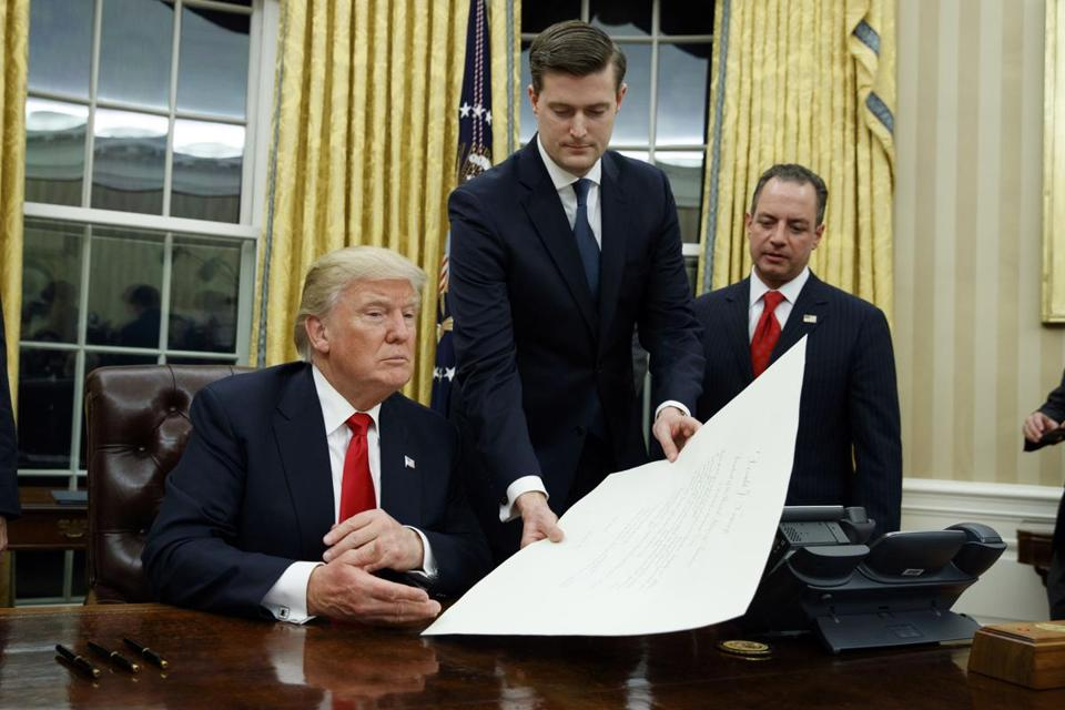 Former White House staff secretary Rob Porter, who resigned last week over accusations that he abused two of his ex-wives, with President Trump in January 2017.