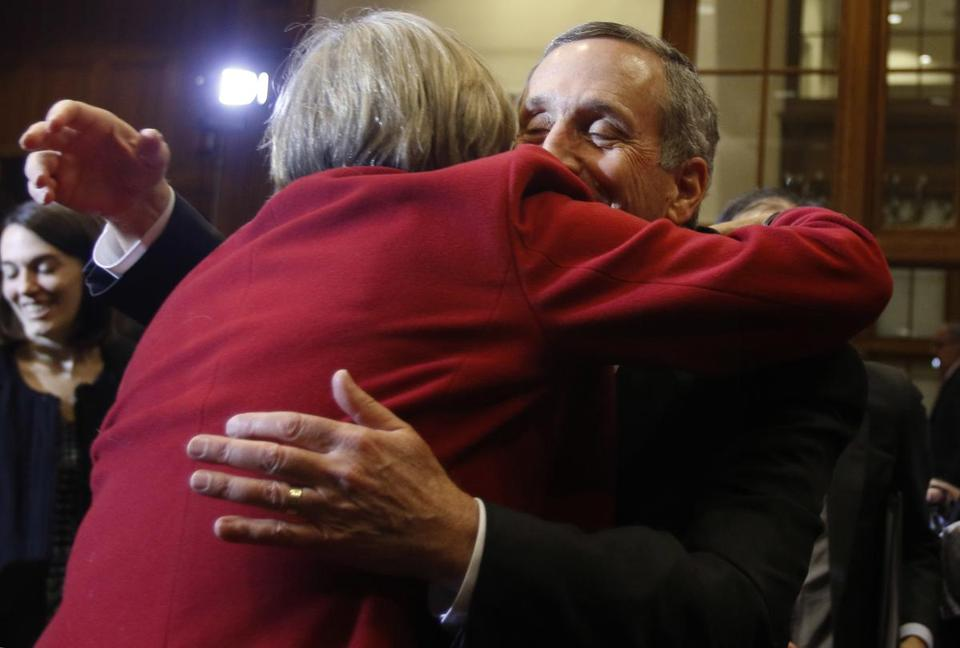 Harvard University president Drew Faust (left) embraced Lawrence S. Bacow after he was introduced as the next president of the school.