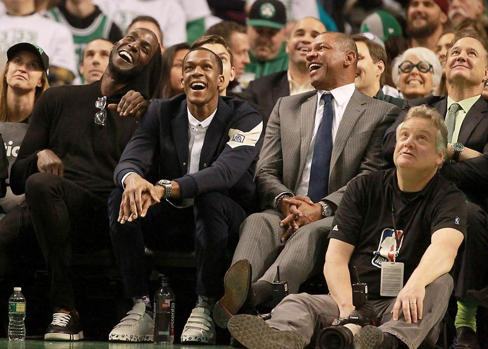 From left: former teammates Kevin Garnett and Rajon Rondo and former Celtics coach Doc Rivers were among those in the crowd Sunday at TD Garden.
