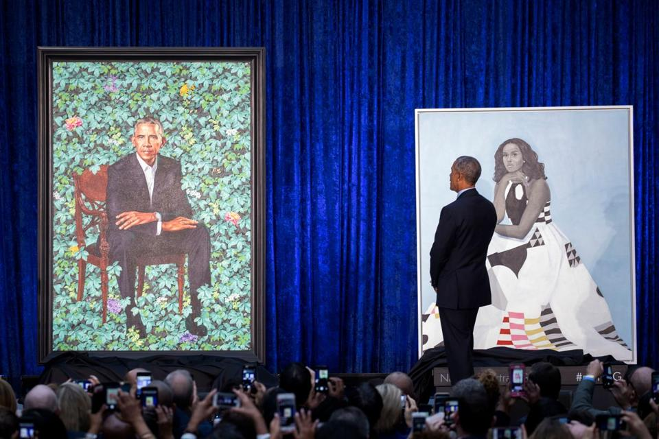Barack Obama examined the portraits during Monday's unveiling.