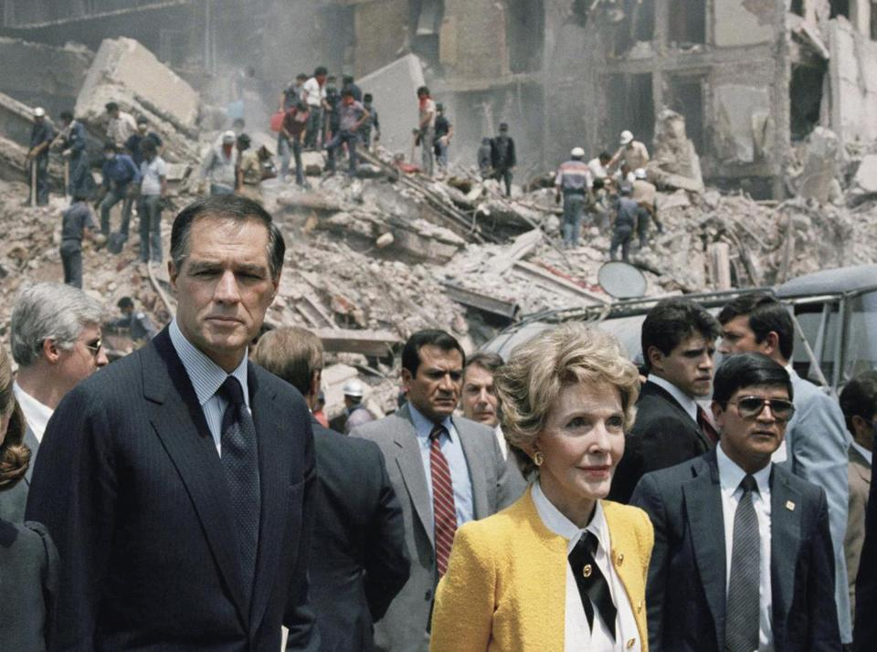 First lady Nancy Reagan and US Ambassador John Gavin (left) viewed earthquake damage in Mexico City in 1985.