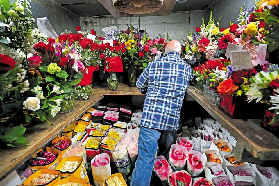 Randy Ricker, owner of Brattle Square Florist in Cambridge, checked on completed orders and their delivery destinations.