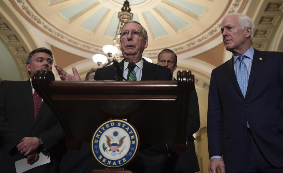 Senate majority leader Mitch McConnell spoke to reporters Tuesday. The Senate debate began with a disagreement between McConnel and minority lader Chuck Schumer.