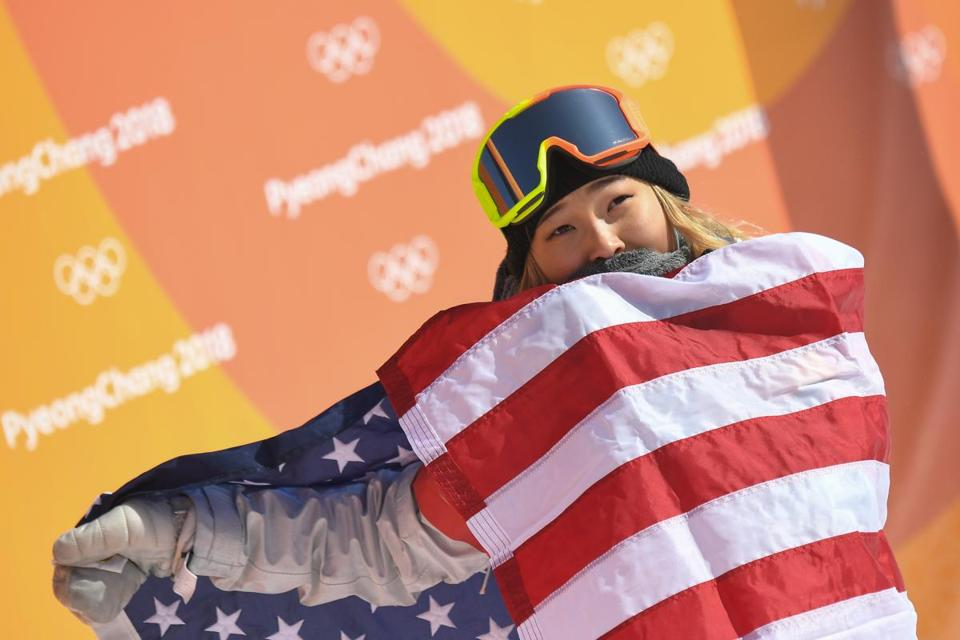 Chloe Kim wrapped herself in an American flag after taking the gold medal in the women's halfpipe.