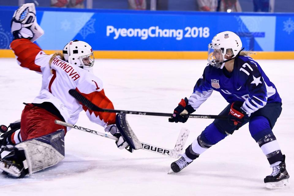 USA's Jocelyne Lamoureux-Davidson (R) scores against Russia's Valeria Tarakanova in the women's preliminary round ice hockey match between the US and Olympic Athletes from Russia during the Pyeongchang 2018 Winter Olympic Games at the Kwandong Hockey Centre in Gangneung on February 13, 2018. / AFP PHOTO / Brendan SmialowskiBRENDAN SMIALOWSKI/AFP/Getty Images