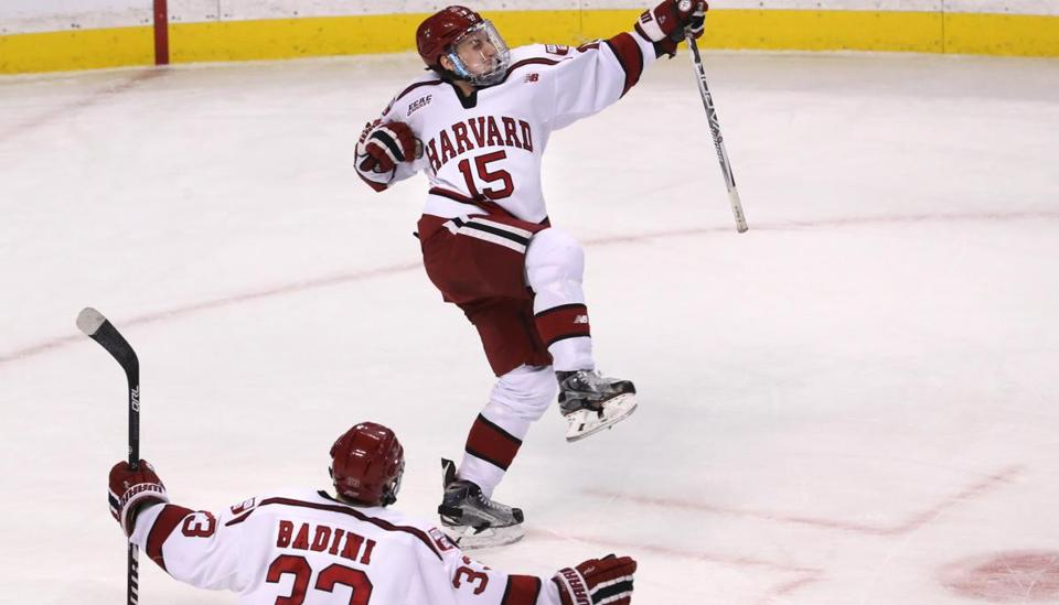 Harvard's Seb Lloyd (15) celebrates his overtime goal in the Beanpot consolation hockey game Monday at TD Garden.