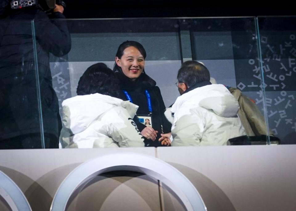 "Kim Yo-jong reaches out to shake hands with President Moon Jae-in of South Korea at the opening ceremonies of the Winter Olympics in Pyeongchang, South Korea, Feb. 9, 2018. The North Korean leader sent a military band and honor guard to greet Kim Yo-jong when she returned from her ""charm offensive"" in South Korea. (Doug Mills/The New York Times)"