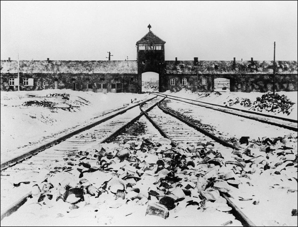 (FILES) This file photo taken in January 1945 shows Auschwitz concentration camp gate and railways after its liberation by Soviet troops in Oswiecim, Poland.