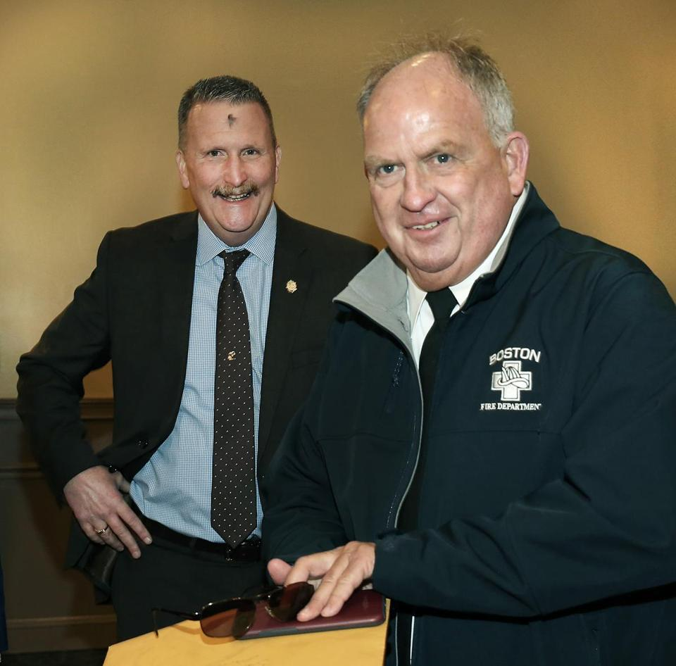 A surprise retirement party was held at Florian Hall for Boston Fire Department Public Information Officer Steve MacDonald (right, with Boston Fire Commissioner Joe Finn).