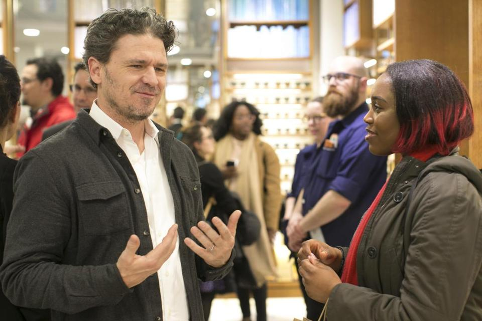 Author Dave Eggers speaks to poet Agnes Ugoji at Warby Parker in Harvard Square.