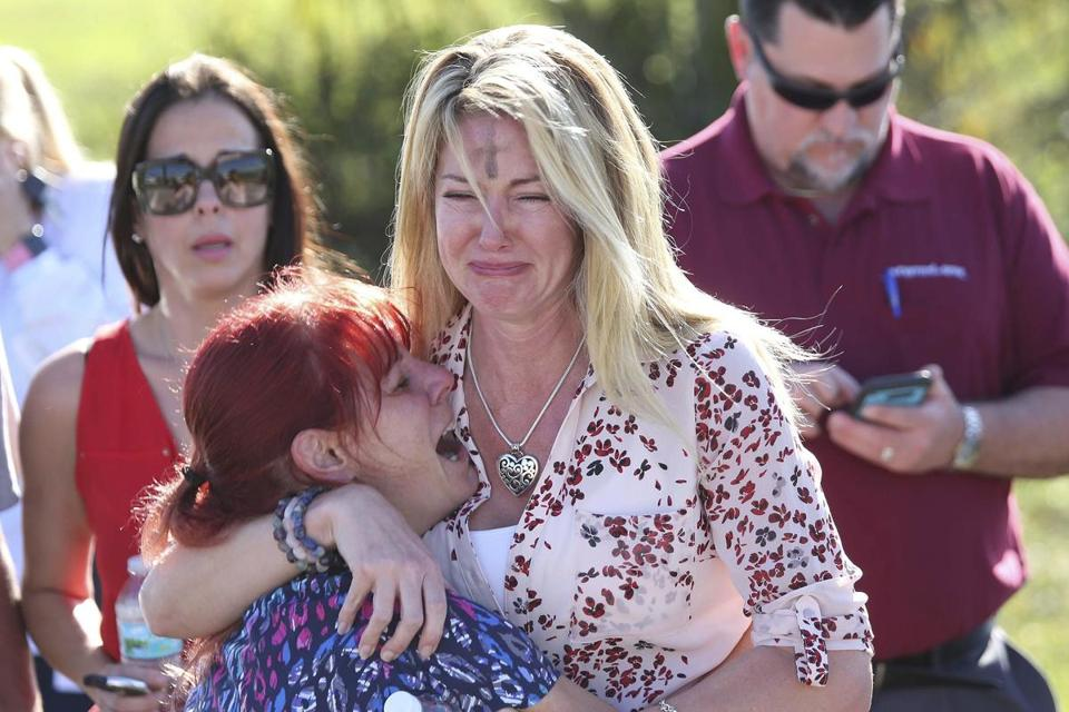 Parents waited for news after a reports of a shooting at Marjory Stoneman Douglas High School in Parkland, Fla.