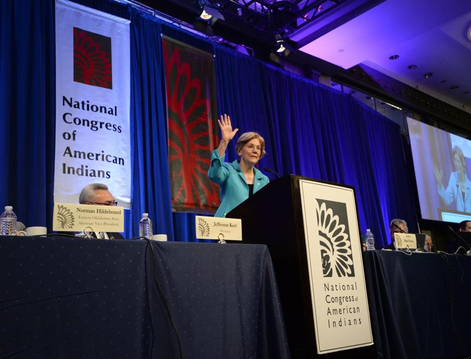 Washington, DC- 021418 MA. Sen. Elizabeth Warren (D), waves to the crowd after speaking on February 14, 2018 at the Congress of American Indians at the Capitol Hilton in DC where she addressed the issue of president Trump referring to her as Pocahontas.(Essdras M Suarez for the Boston Globe)