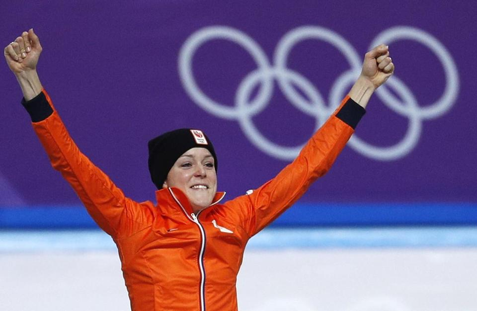 Gold medallist Jorien ter Mors of The Netherlands celebrates on the podium after the women's 1,000 meters speedskating race at the Gangneung Oval at the 2018 Winter Olympics in Gangneung, South Korea, Wednesday, Feb. 14, 2018. (AP Photo/John Locher)