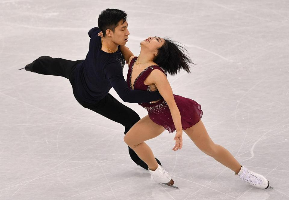 TOPSHOT - China's Sui Wenjing and China's Han Cong compete in the pair skating short program of the figure skating event during the Pyeongchang 2018 Winter Olympic Games at the Gangneung Ice Arena in Gangneung on February 14, 2018. / AFP PHOTO / Mladen ANTONOVMLADEN ANTONOV/AFP/Getty Images