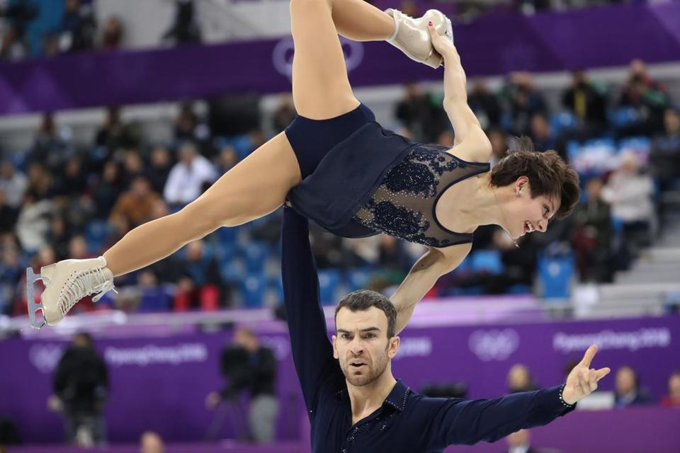 Pairs skaters Meagan Duhamel and Eric Radford of Canada perform during the short program.