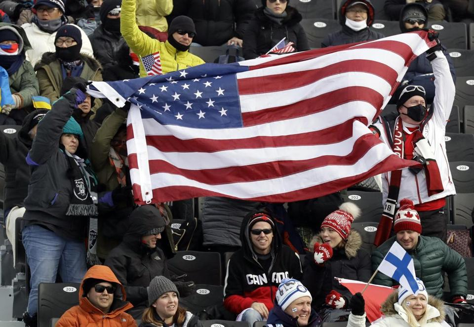 American Olympic fans cheered during a weather delay prior to the men's slopestyle qualifying on Saturday.