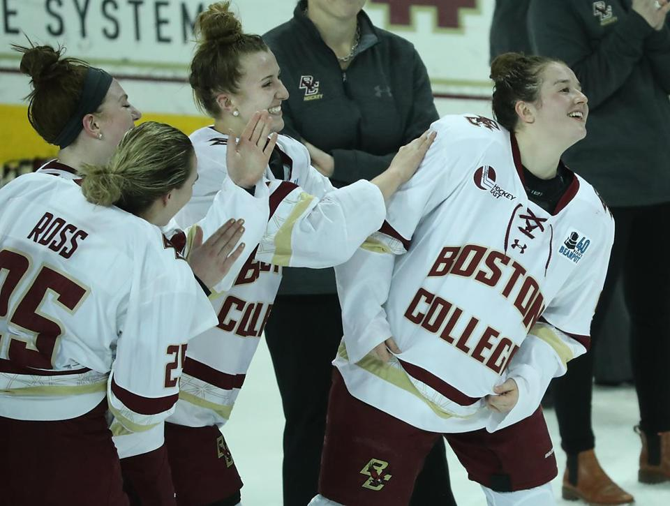Chestnut Hill MA 02/13/18 Boston College Eagles Daryl Watts getting pats on the back as she was named MVP of the Beanpot Tournament after they defeated Boston University Terriers 4-3 in the overtime period of the Beanpot Championship game at the Conte Forum. (Matthew J. Lee/Globe staff) topic: reporter: