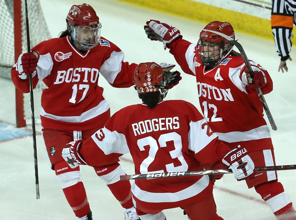 BU's Victoria Bach (right) celebrates her goal with Breanna Scarpaci (17) and Nina Rodgers during the second period at Conte Forum.