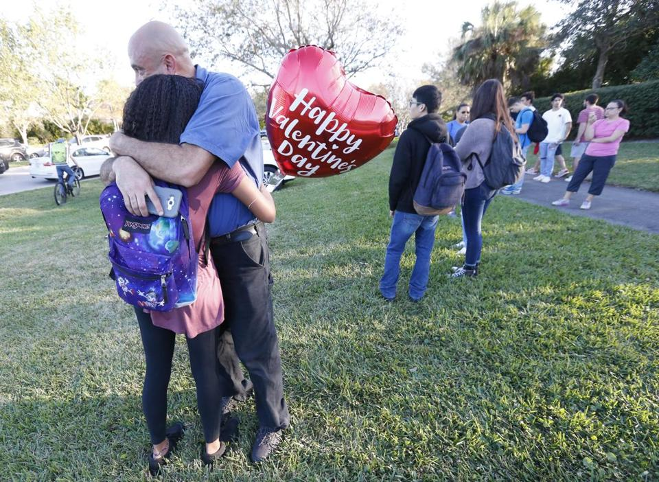 Family members embraced outside Marjory Stoneman Douglas High School following a shooting.